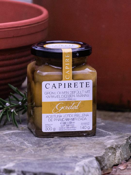 Grüne Oliven gefüllt mit karamellisierter Ananas